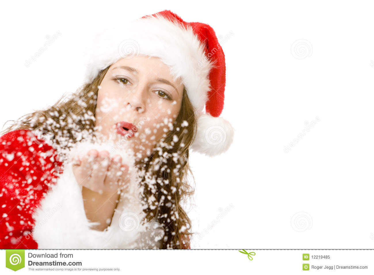 Santa Claus woman is blowing Christmas winter snow
