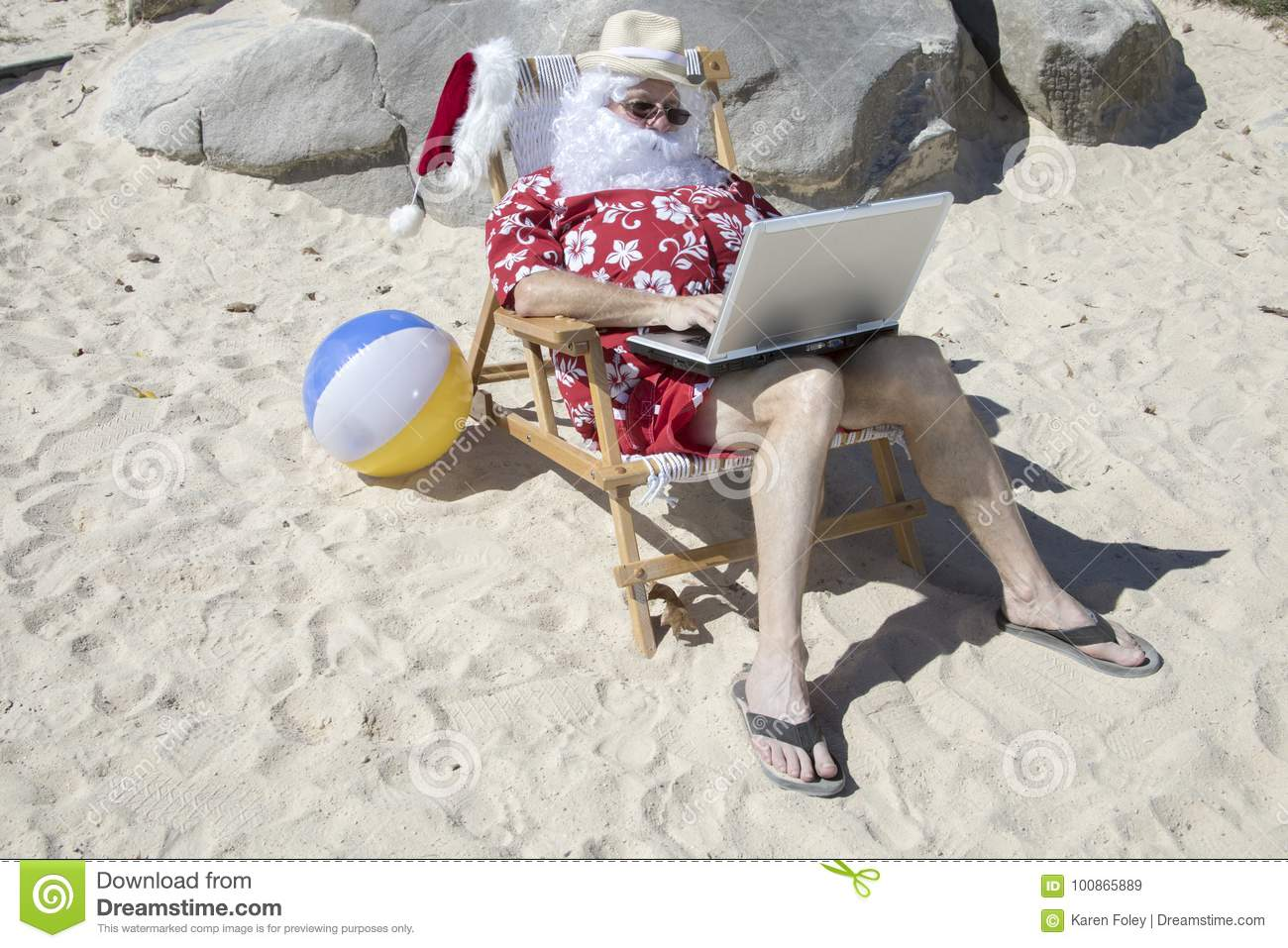 Remarkable Santa Claus Working On Beach Chair Working With Laptop Ocoug Best Dining Table And Chair Ideas Images Ocougorg