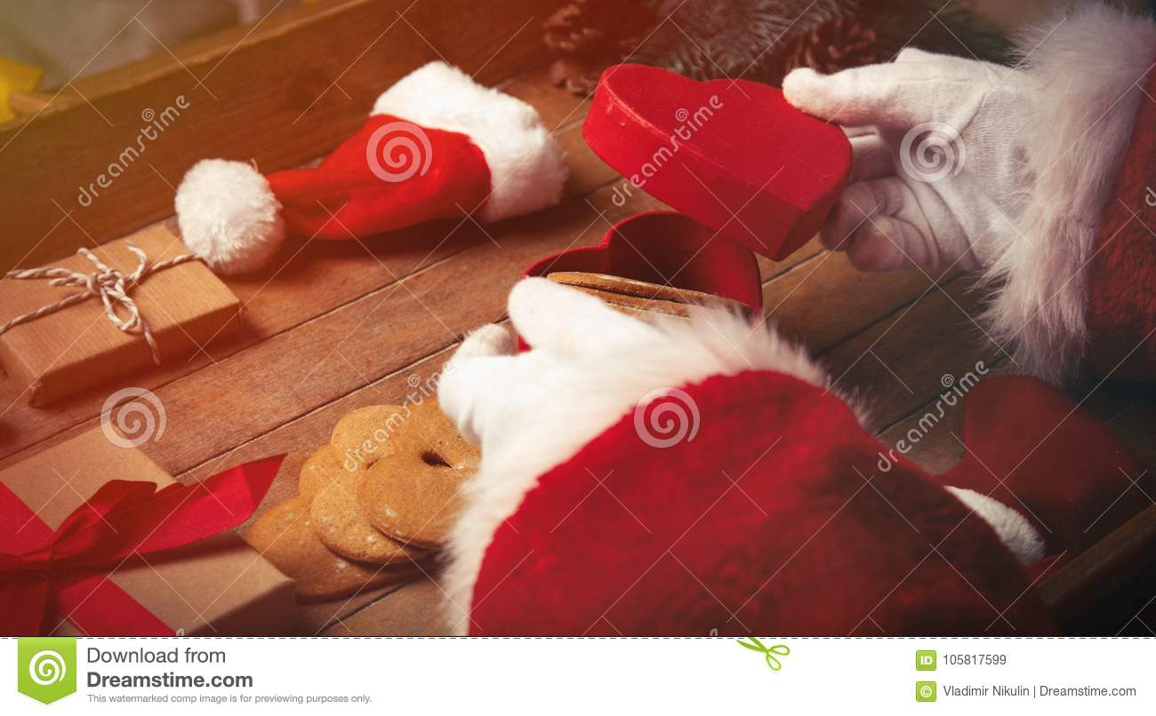 Santa Claus Wrapping Up Christmas Gifts And Cookies Stock Image ...