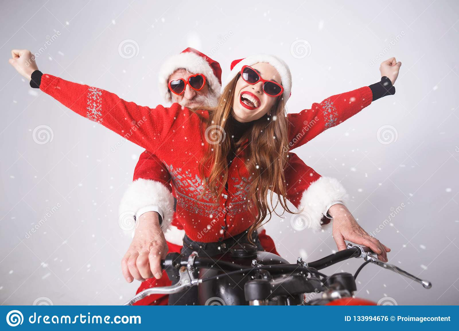 Santa Claus And Young Mrs Claus Riding A de Motorfiets