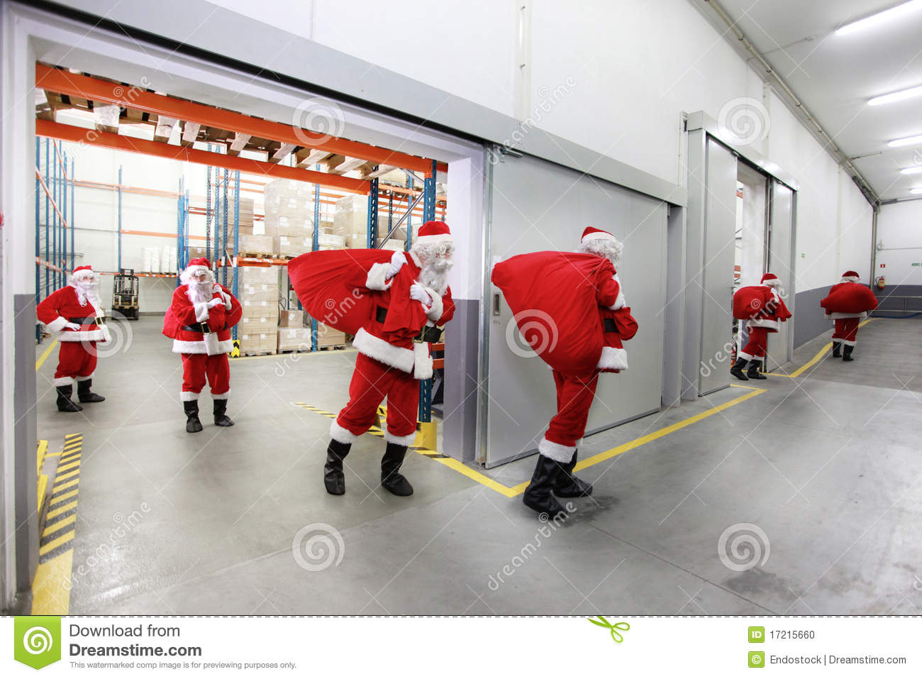 Santa clauses leaving a gift distribution center