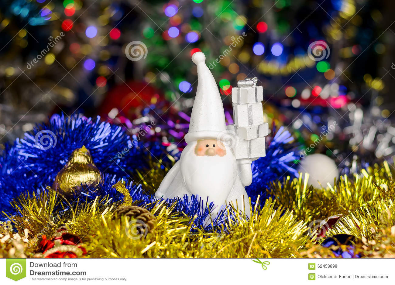 Santa figure with christmas balls tinsel on blurred