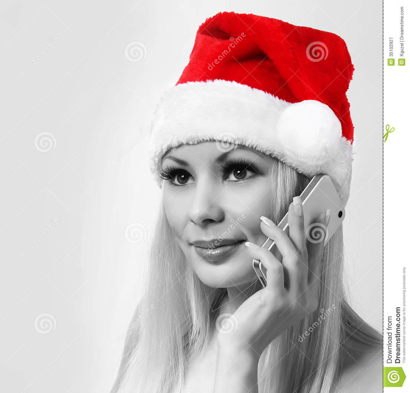 Santa Girl With Cell Phone. Blonde Happy Young Woman With