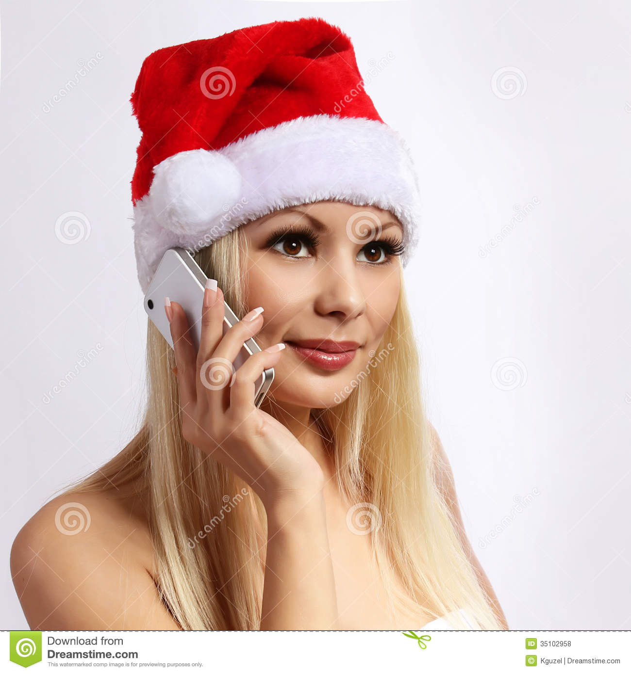 Santa Girl With Cell Phone. Blonde Happy Young Woman Stock
