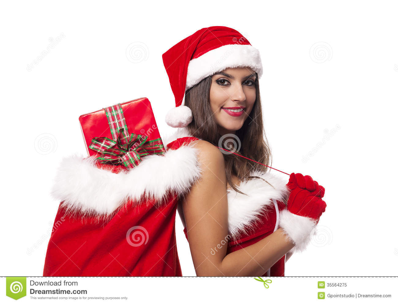 Beautiful woman wearing santa claus clothes holding sack full of ...
