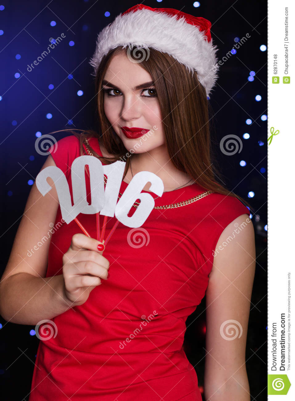Santa girl is holding paper digits 2016