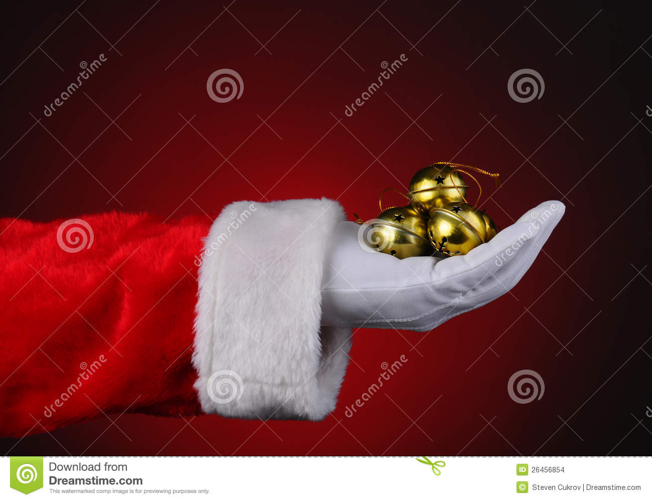 Santa with handful of sleigh bells stock photo image