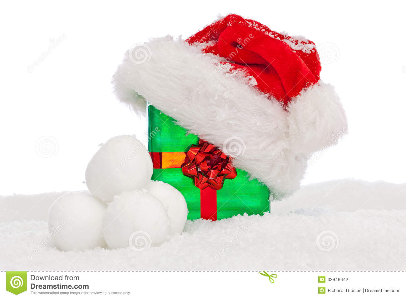 Santa Hat On Christmas Present Covered In Snow. Stock Photo - Image ...