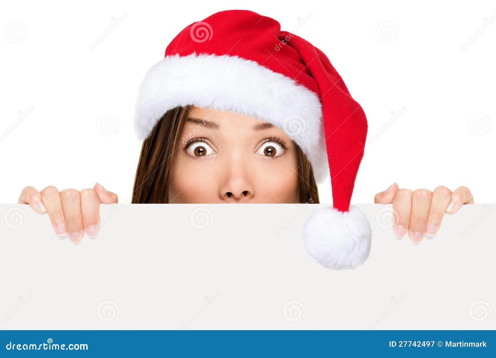Santa hat woman showing christmas sign