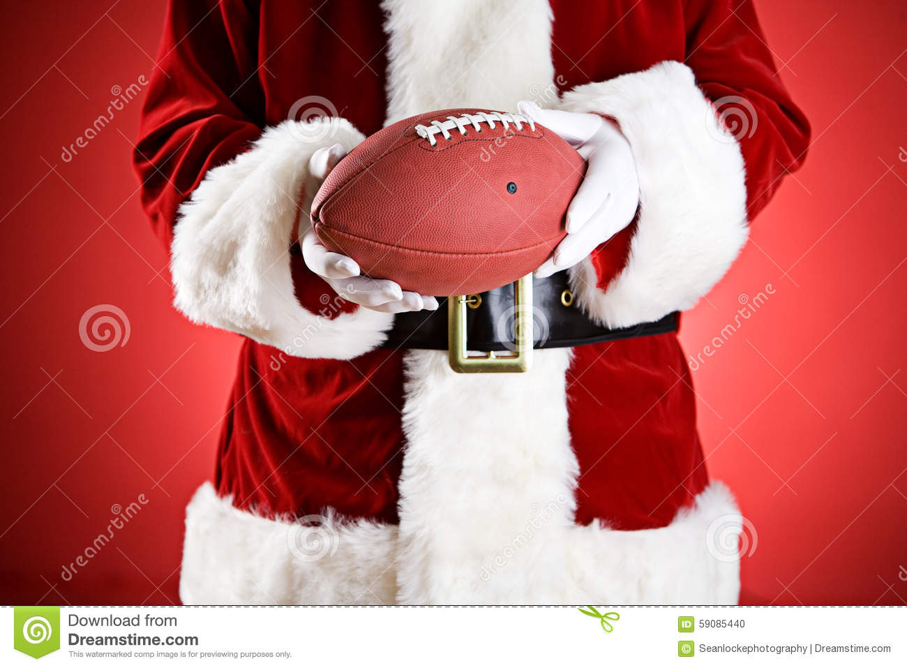 Santa American - Football An 59085440 Of Ball Stock Photo Holding Anonymous Image