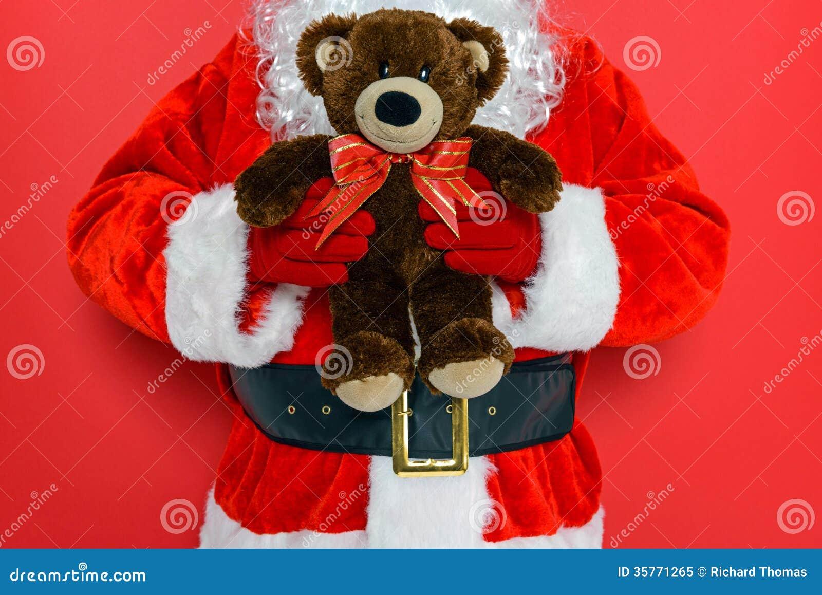Santa holding a teddy bear royalty free stock photo