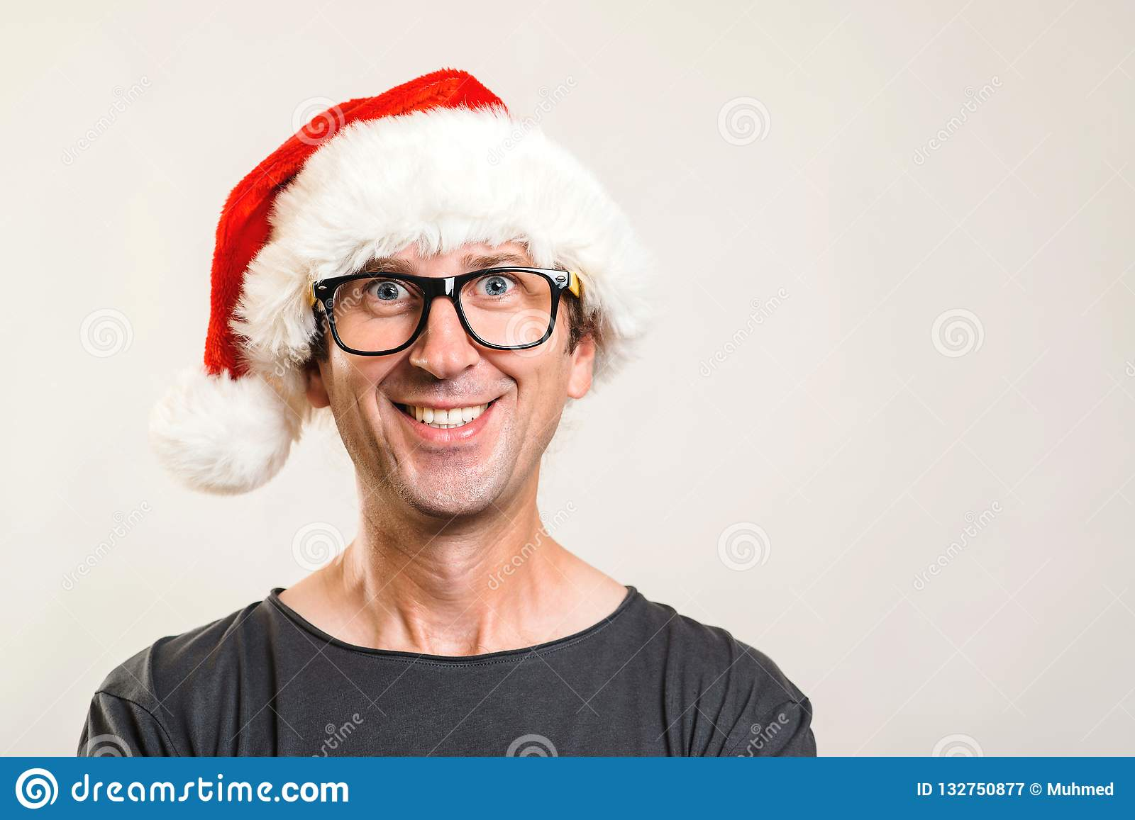 Santa man portrait. Christmas concept. Funny man wearing glasses and christmas hat. Happy New Year. Copy space