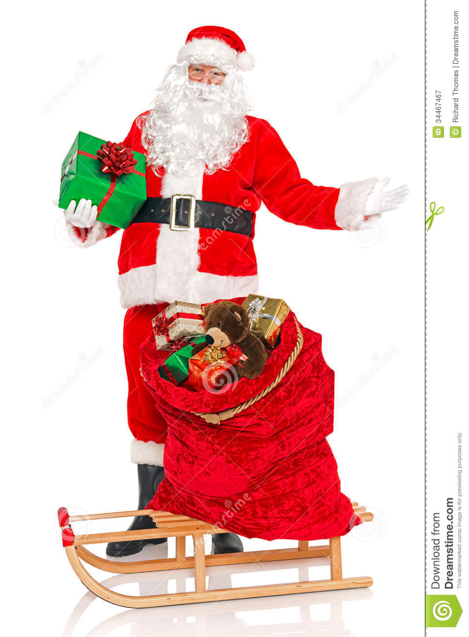 Toys From Santa : Santa with sack of toys and sledge isolated stock image