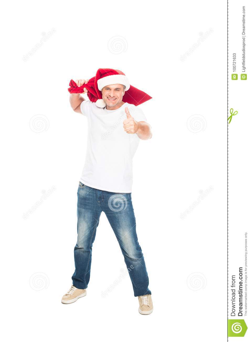 5c0a223a4306c Happy man in Santa hat with big bag full of presents for Christmas showing  thumb up
