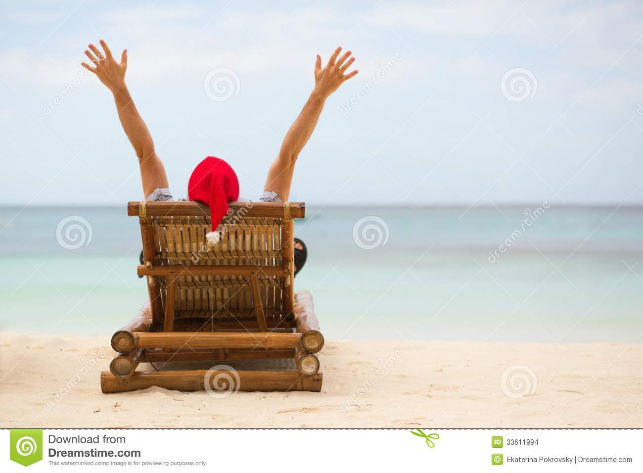Santa sitting on chaise longue on beach stock images for Beach chaise longue