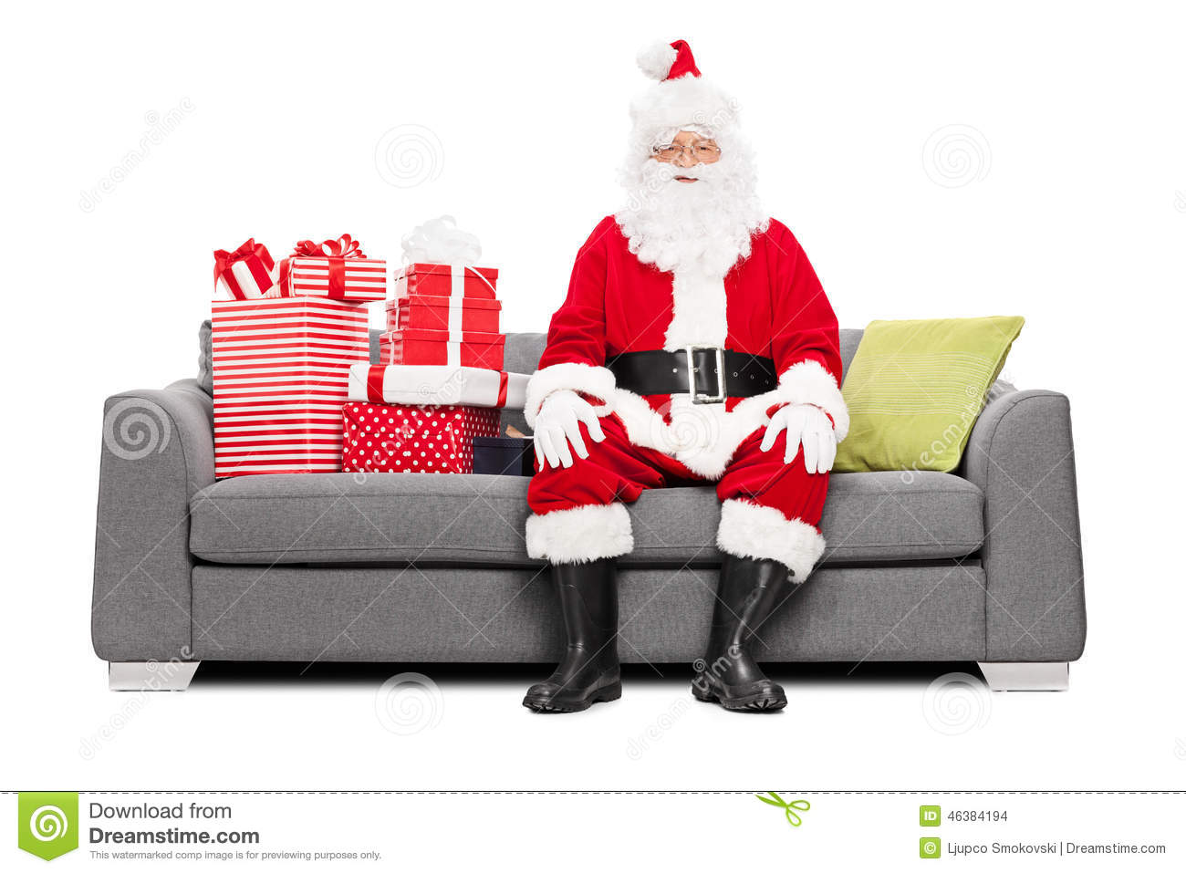 Santa sitting on a couch full of christmas presents stock