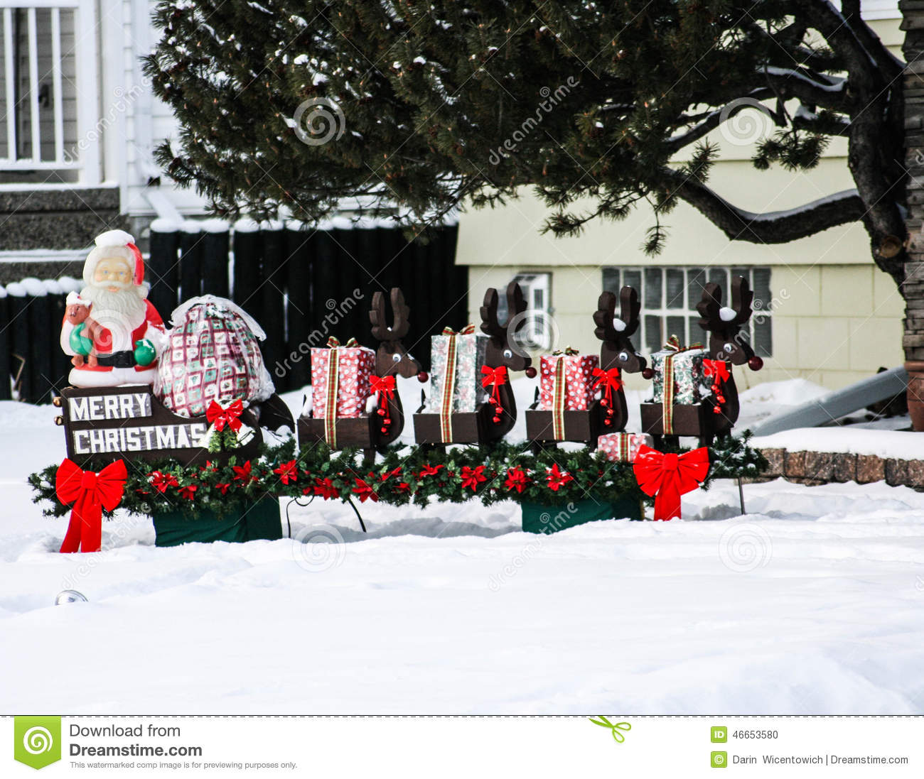 Santa Claus Lawn Decorations: Santa And Sleigh Lawn Decoration Stock Photo