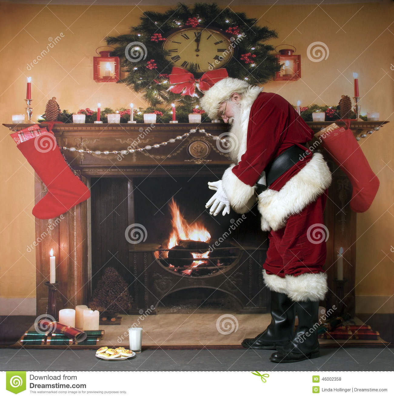 Santa Warming By The Fireplace Stock Photo Image Of