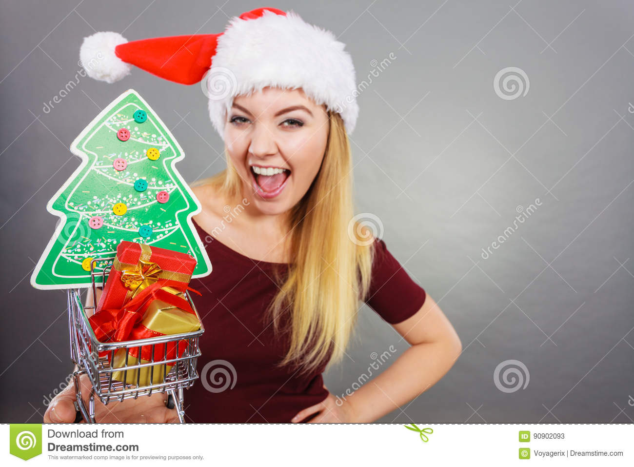 Santa Woman Holding Shopping Cart With Christmas Gifts Stock Image ...