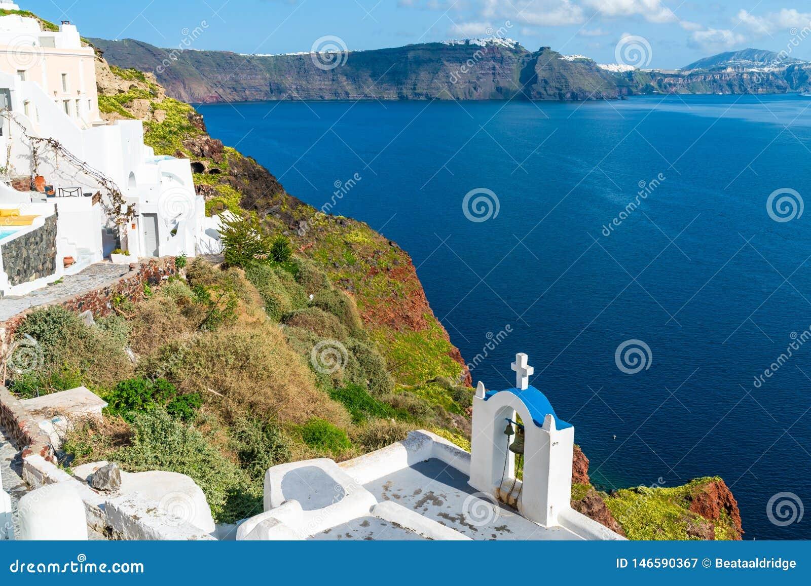 Santorini landscape in Oia with view of caldera and Aegean Sea