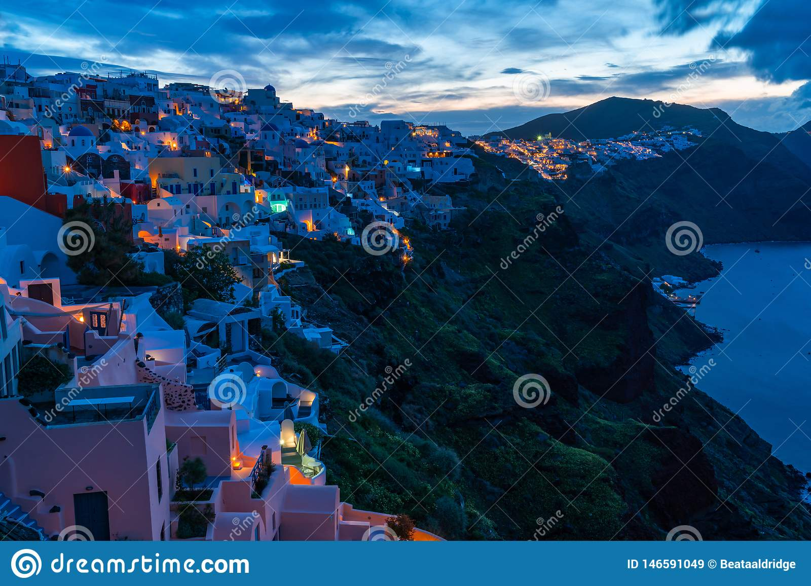 Santorini landscape with view of Oia at sunrise