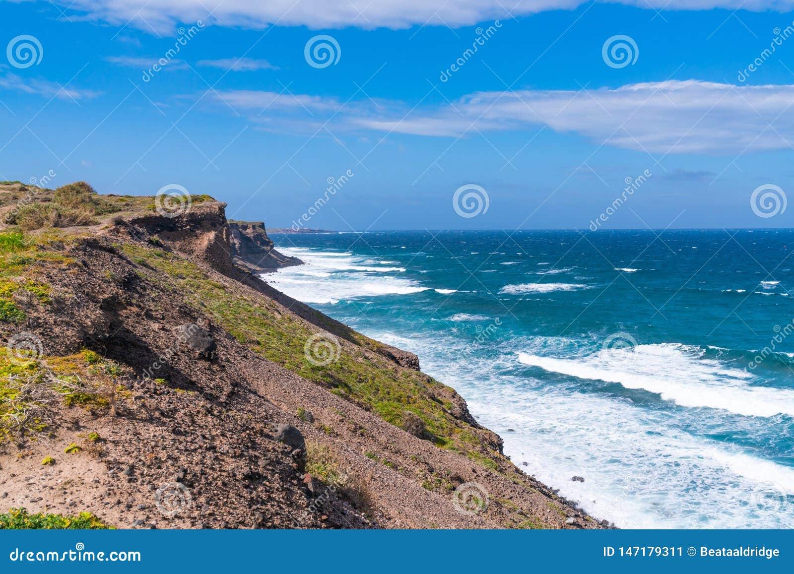 Santorini landscape - view of rugged cliffs and Aegean Sea