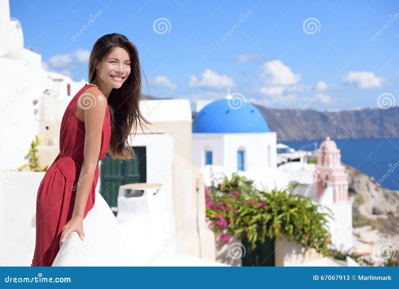 Santorini tourism - Asian woman on summer travel