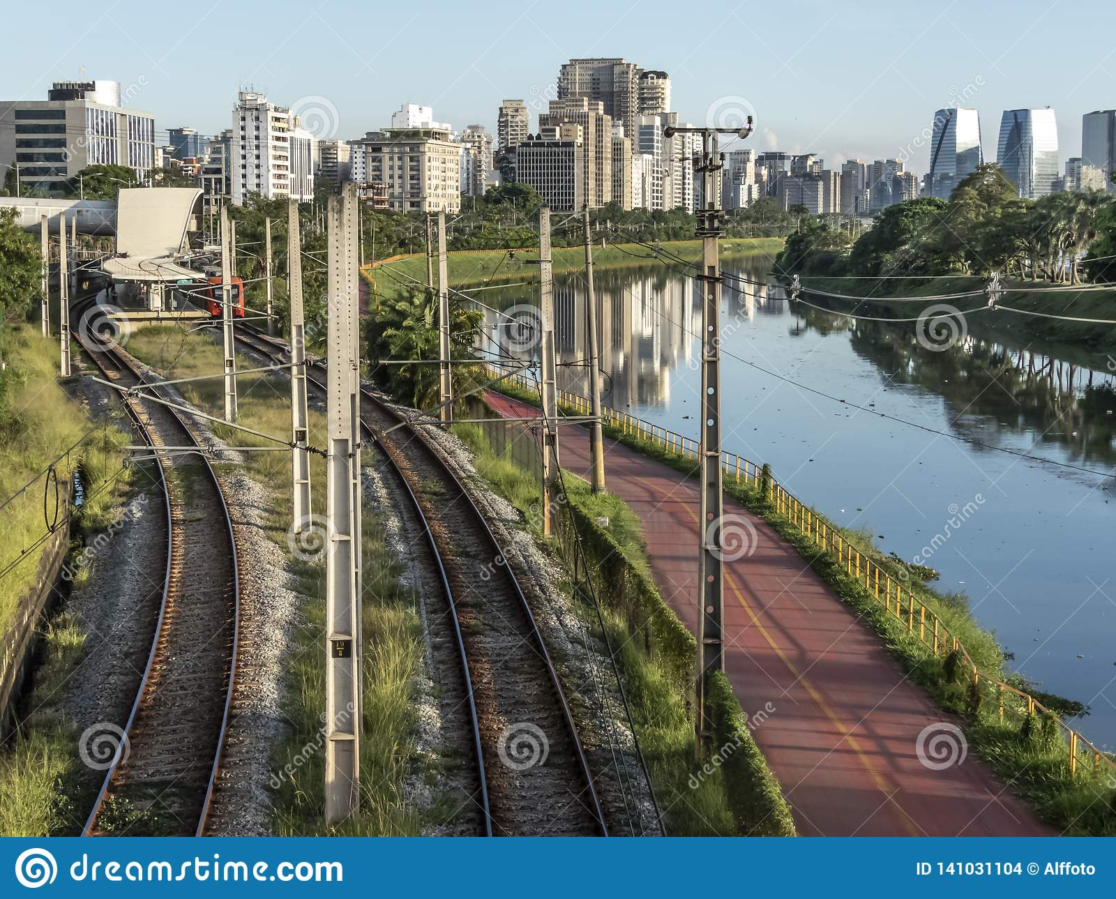 Cyclist on bicycle Lane near of Pinheiros River,