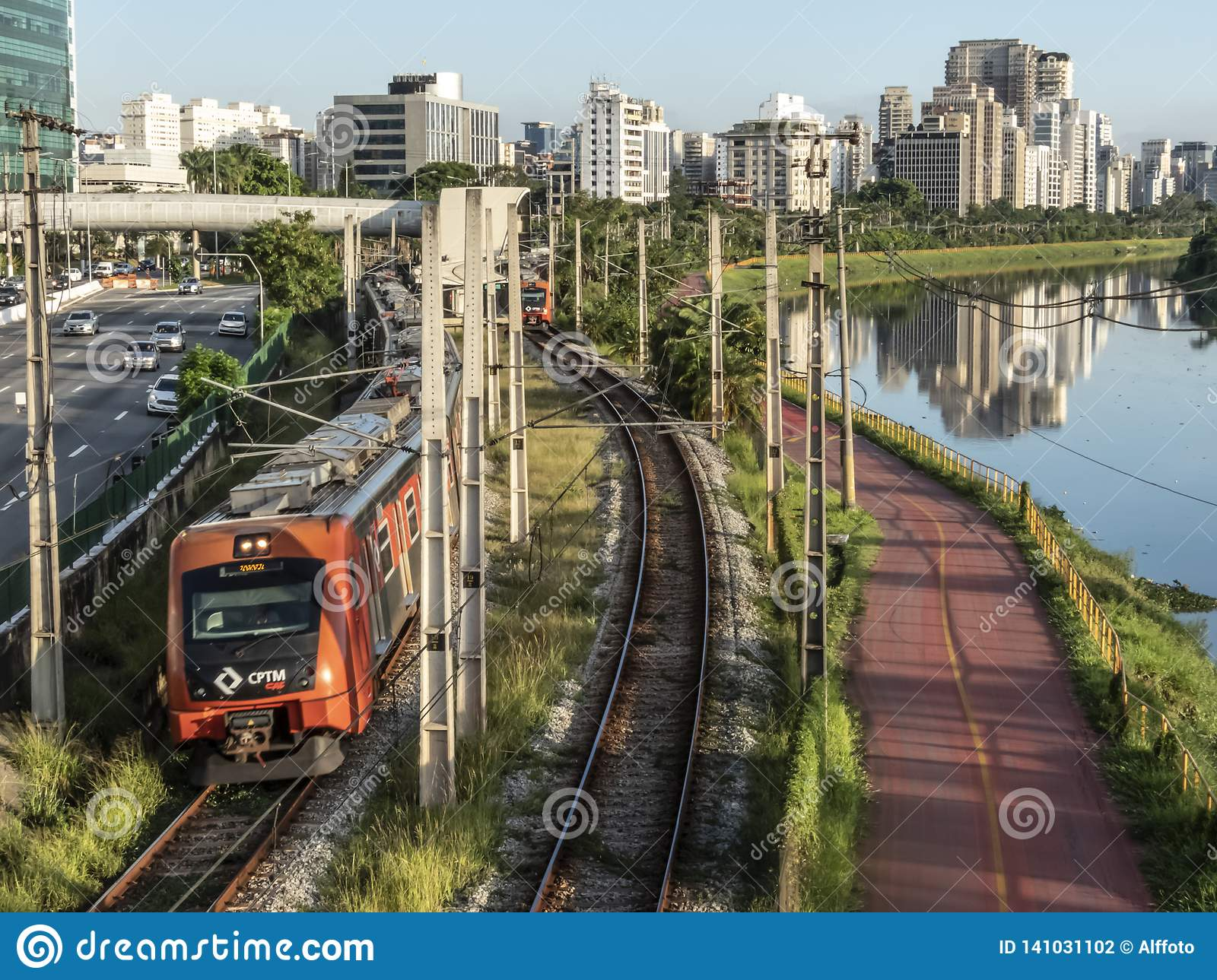 View of buildings, CPTM train, traffic of vehicles and river in Marginal Pinheiros River Avenue