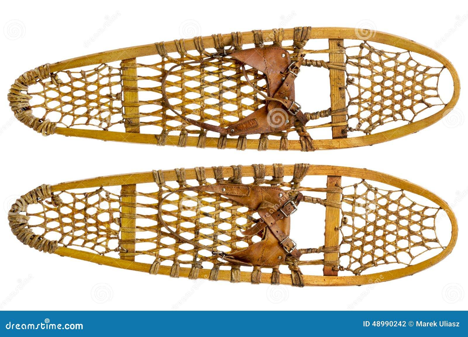 3b11cf63a Um par de sapatos de neve de madeira da pata de urso do vintage com o  emperramento de couro isolado no branco