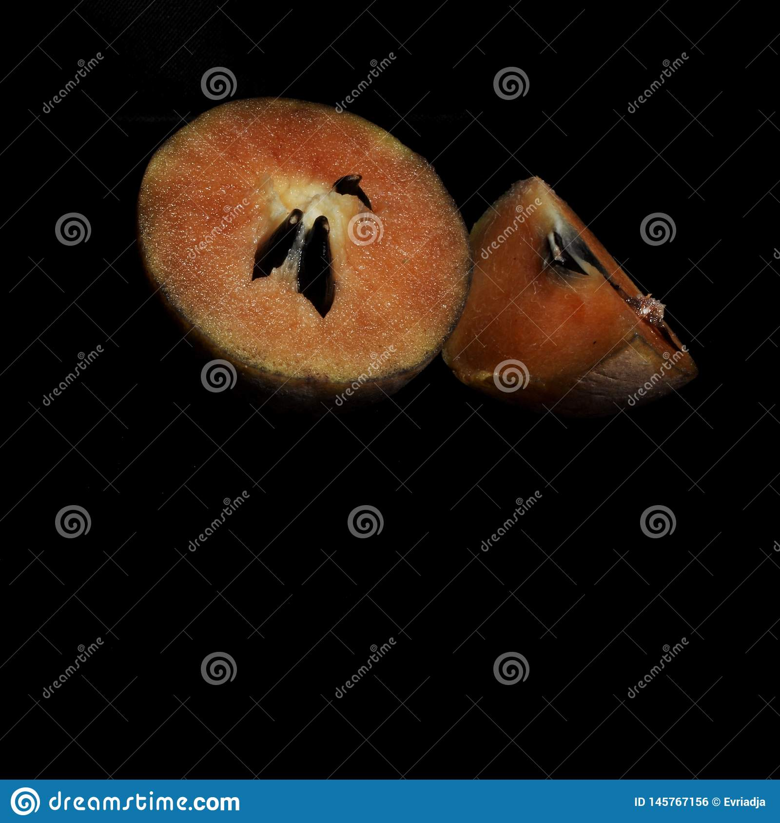 Sapodilla fruit isolated on black background
