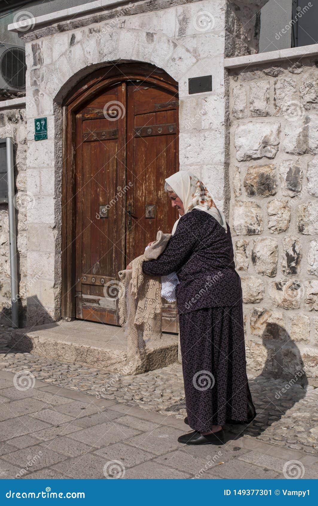Sarajevo, Bosnia and Herzegovina, Bascarsija, neighborhood, old town, district, square, people, bazaar, market, woman