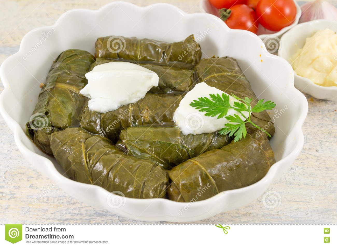Sarma rolls in a plate covered with spices