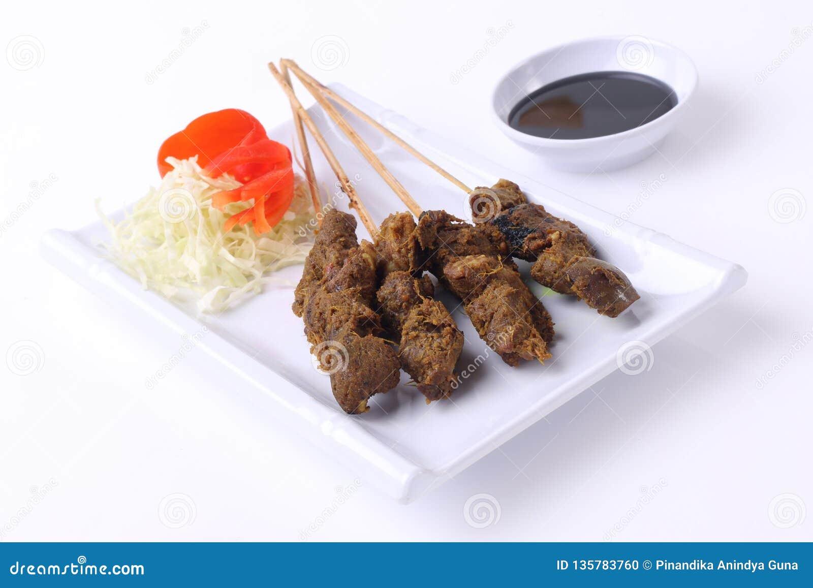 Satay Indonesia food on white plate