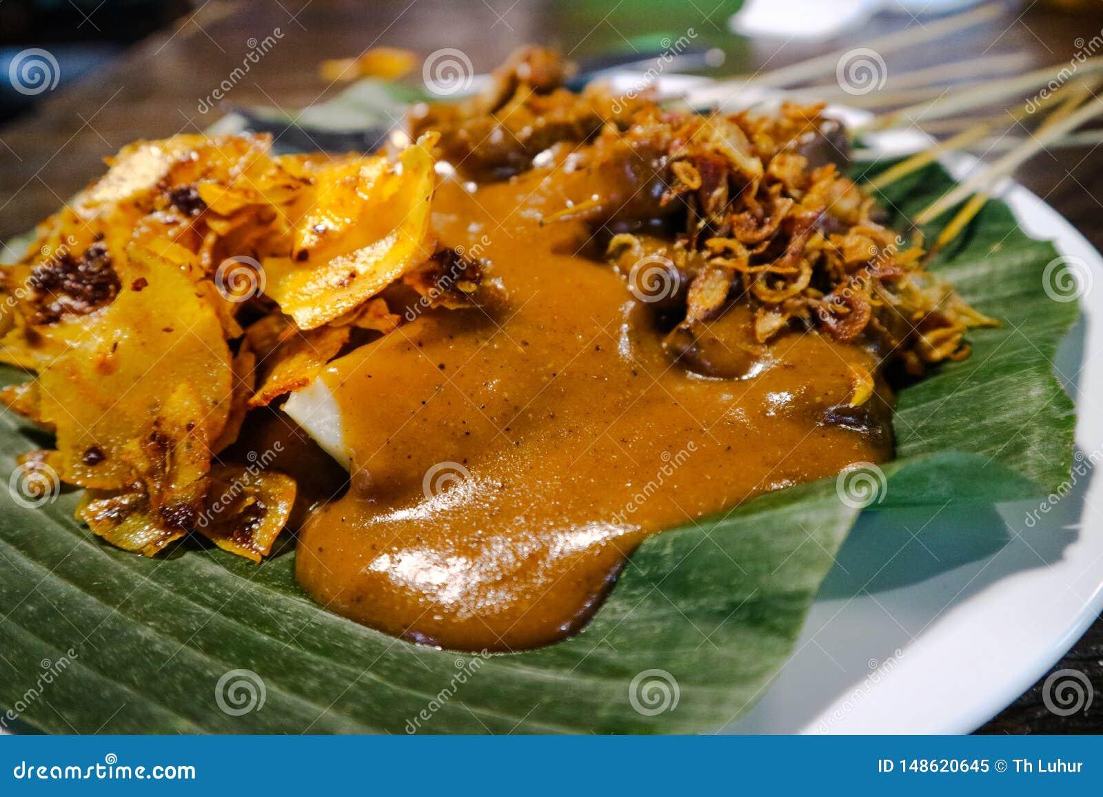 Satay Padang med kryddigt kryddamatk?nnetecken av det indonesiska Padang omr?det