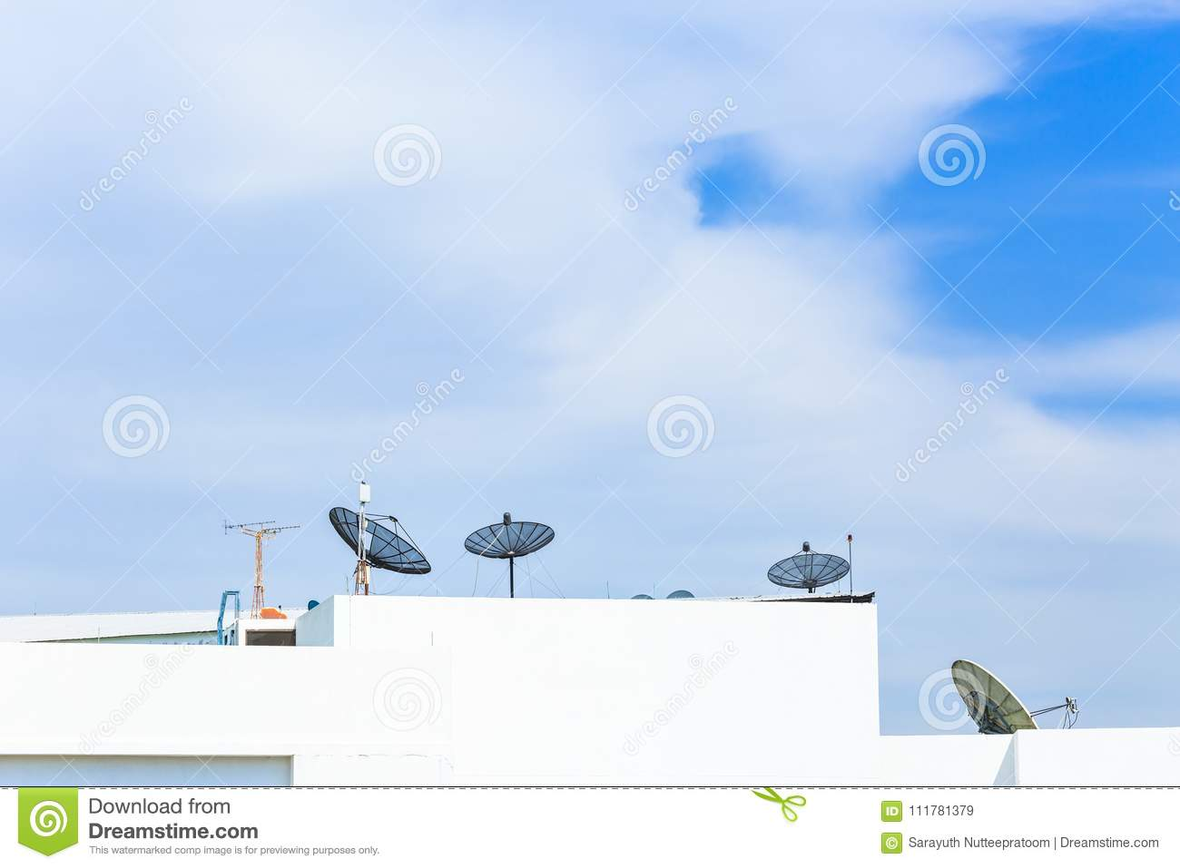 Satellite dish antenna on top of the building in urban area at n