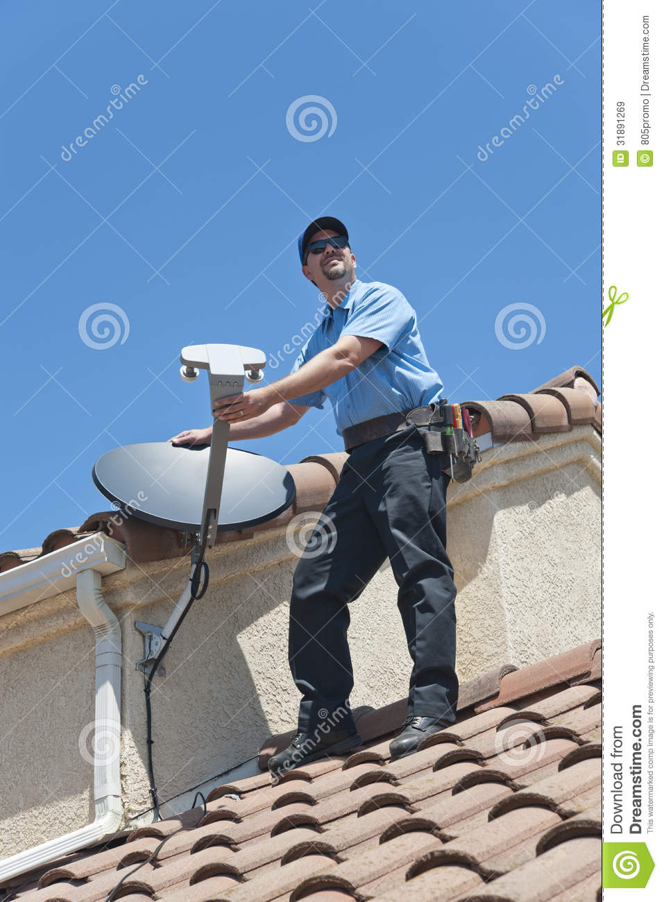 Satellite Installer On Roof Royalty Free Stock Images