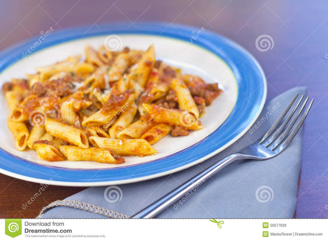 Penne pasta with ground beef meat sauce.