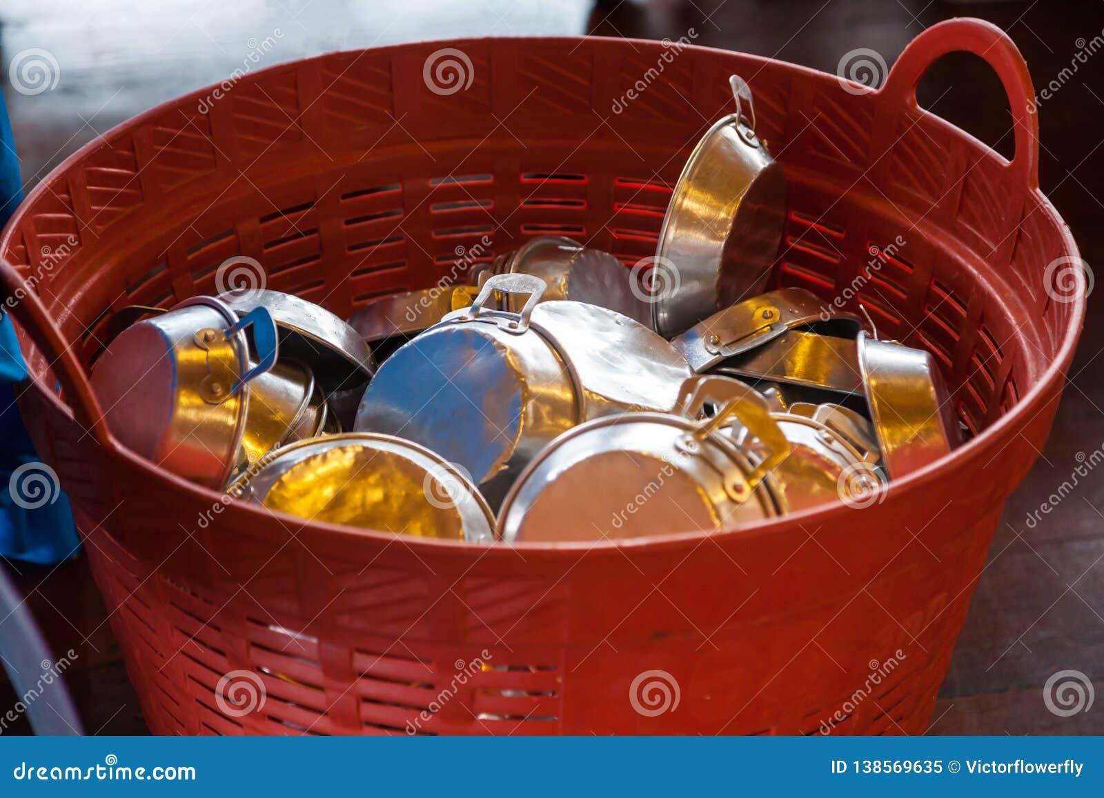Saucepans casserole, cooking vessel with handle kept in basket in kitchen warehouse storage. Food Industry Utensils, Kitchenware