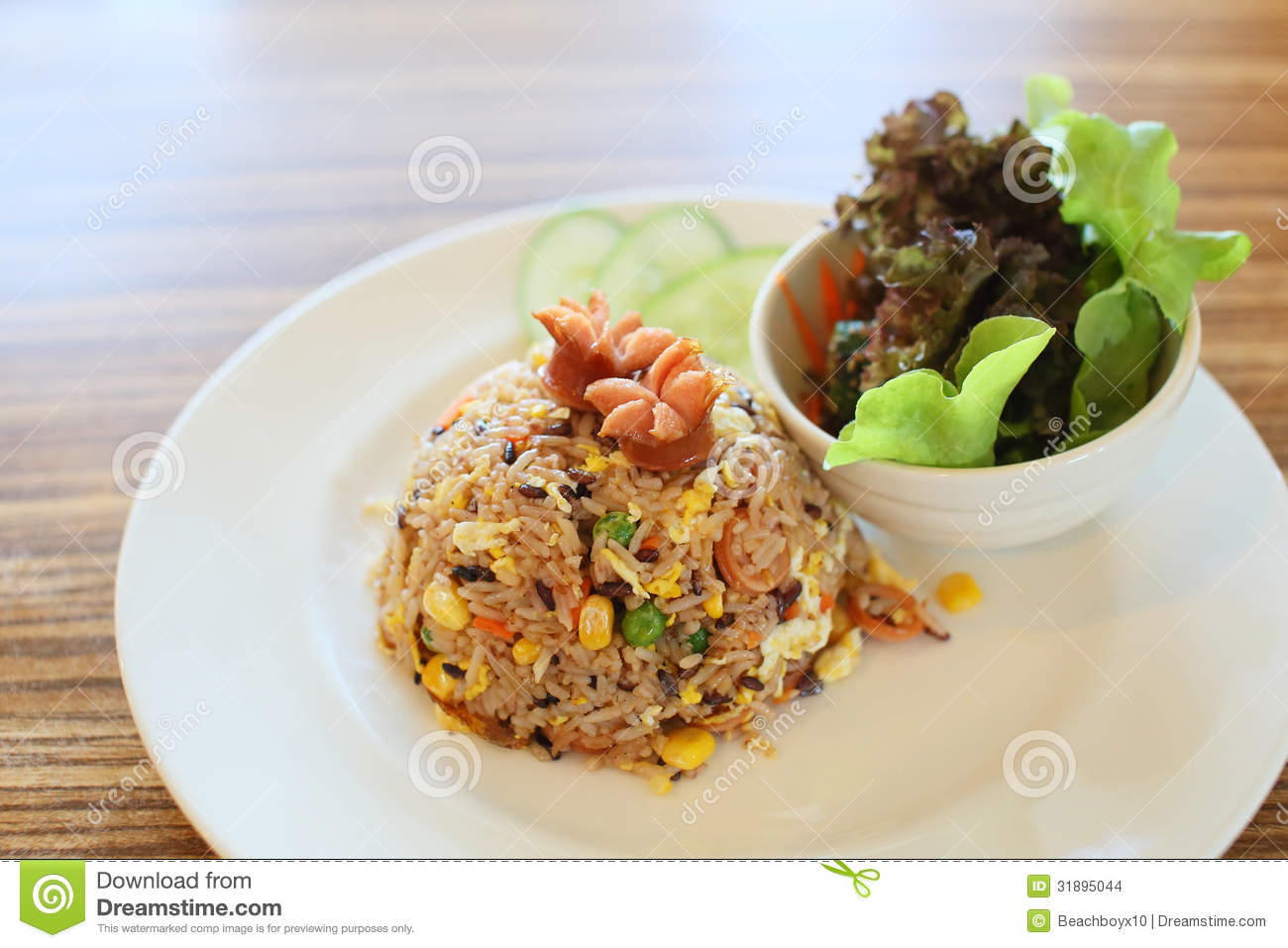 Stock Images: Sausage fried rice and Salad