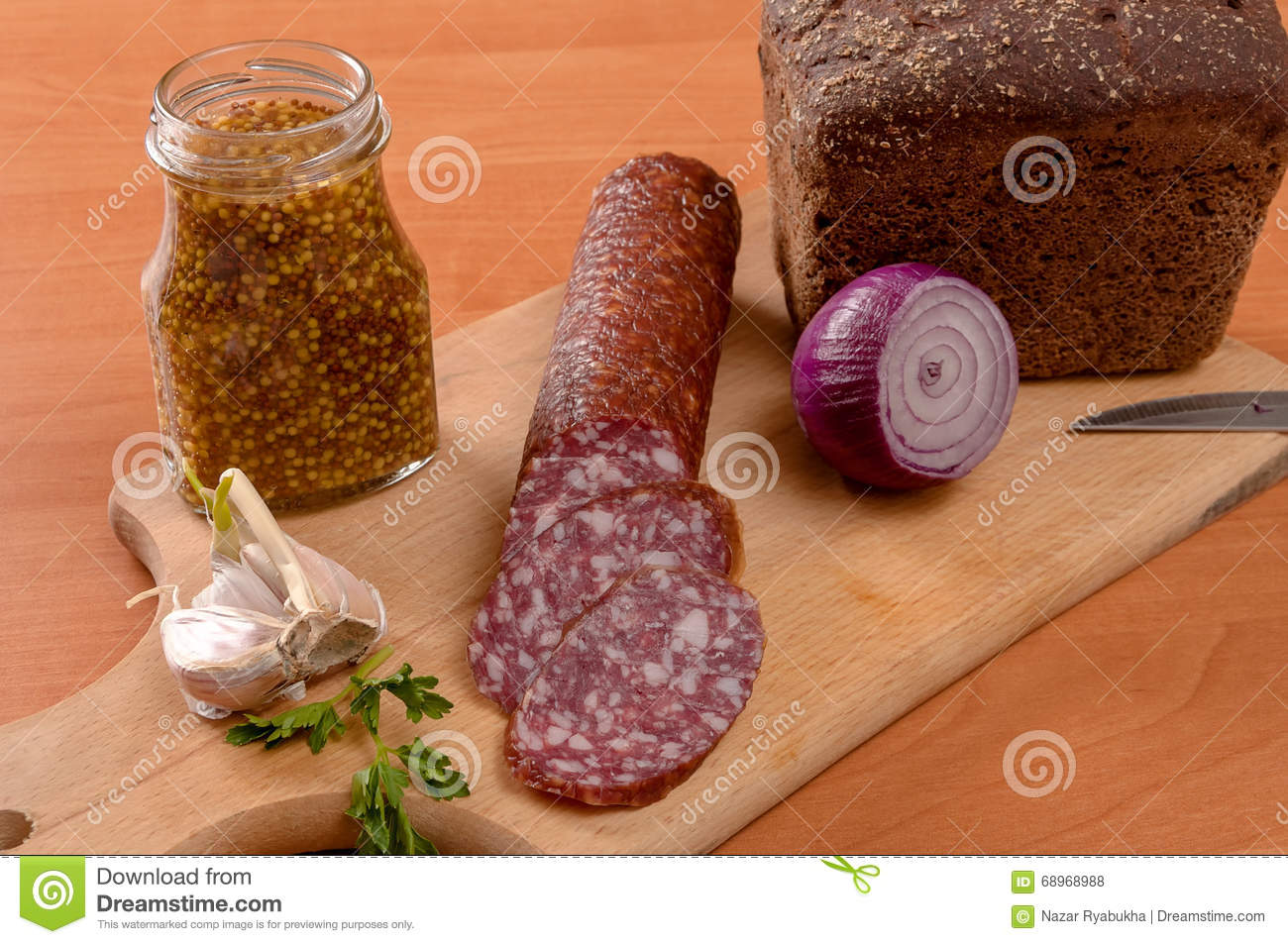 Sausage sliced with knife on a wooden table