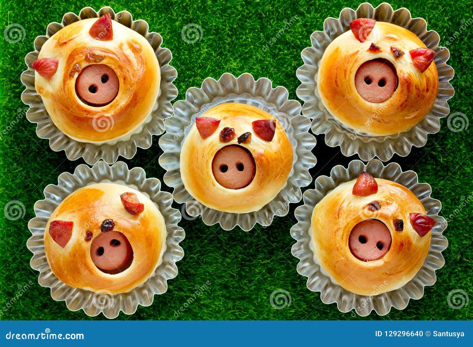 Sausage stuffed piglet buns, homemade burger buns shaped funny pigs faces