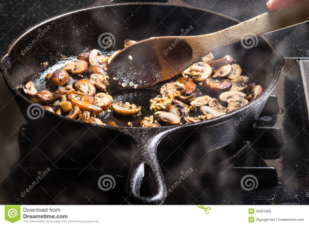 Sauteing Sliced Mushrooms In A Skillet Stock Photos ...