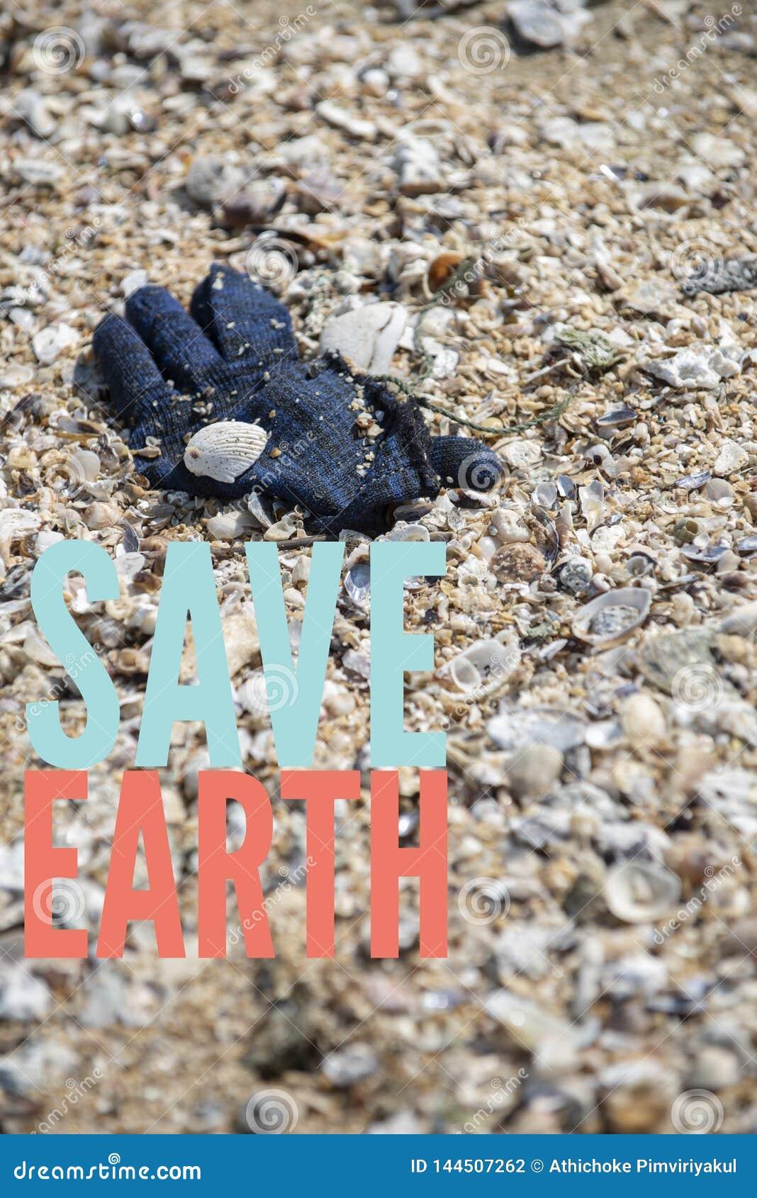 A deep blue winter yarn glove found trashed on the beach. Save Earth please!