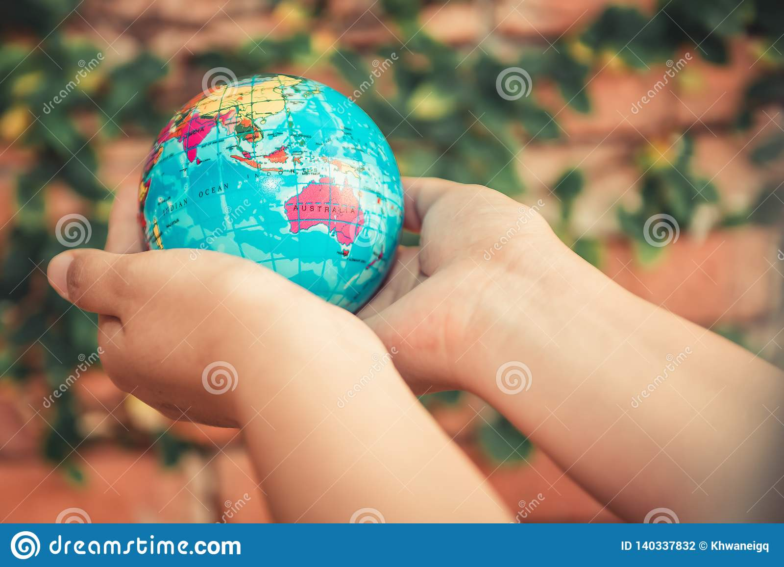 Save The Earth Concept, Woman Hands is Holding Mockup The Global on Tree Leaves Background. Creative Idea for Conservation