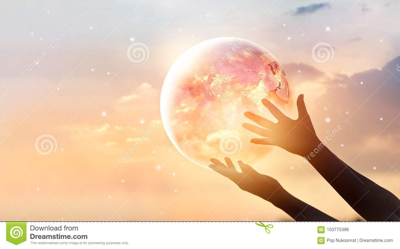 Save the world energy campaign.Planet earth on human hands show