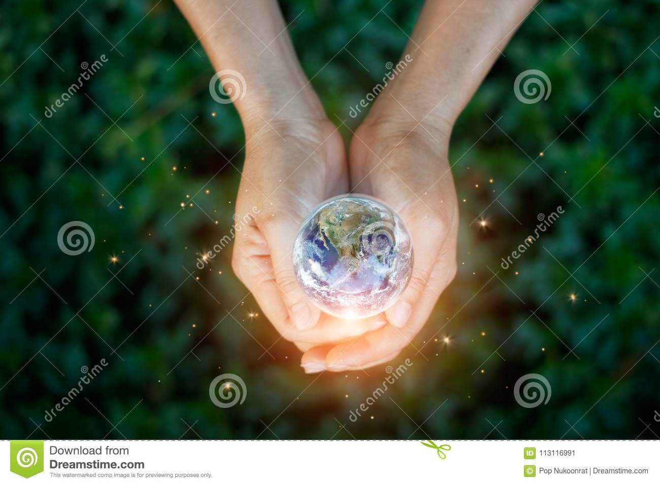 Saving energy concept, Hand holding earth against nature