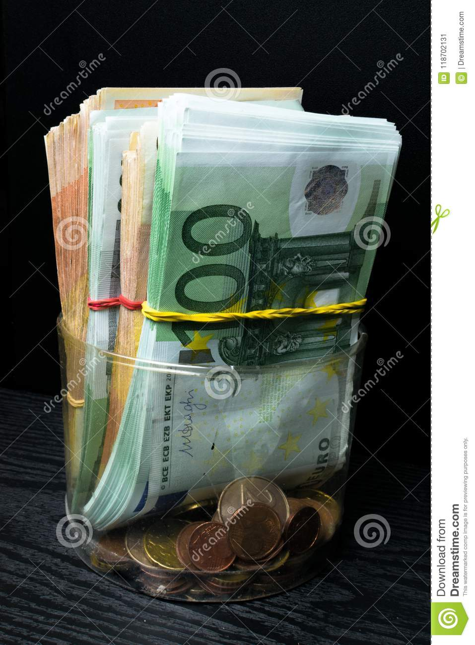 Saving money box with euro banknotes, cents. Banknotes of the european union. Euro cash background.