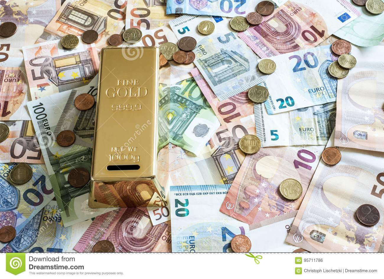 Savings Cash money concept euro banknotes all sizes and cent coins on desk piggy bank gold bar shape save