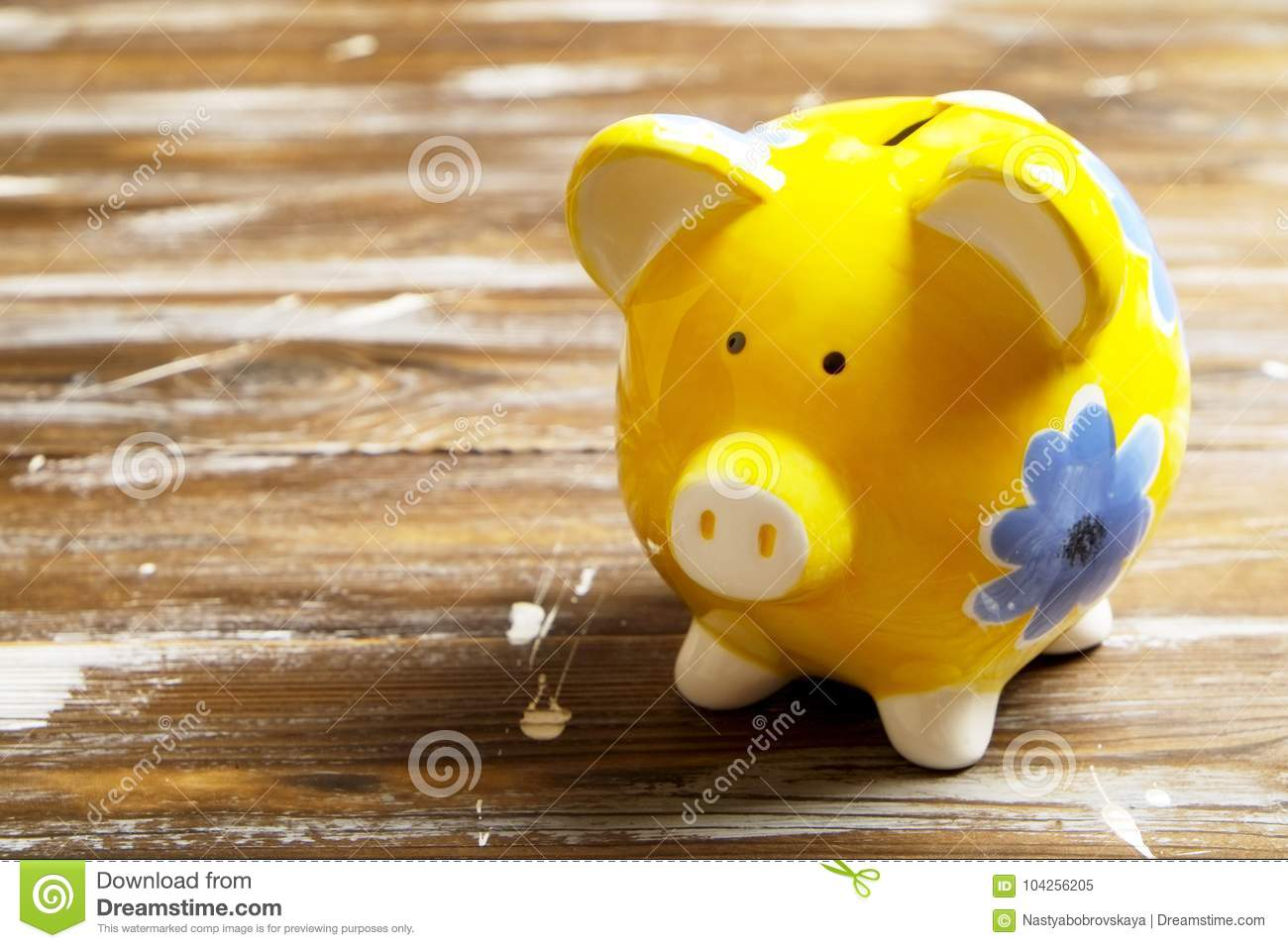 Savings concept. Piggy bank and money on dark wood background